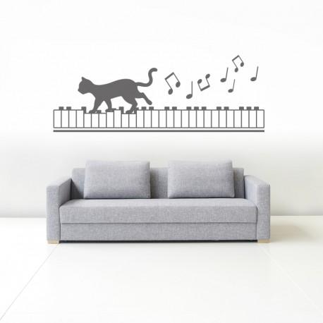 vinilo gato sobre piano